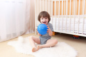 Little boy with ball indoors — Stock Photo