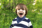 Portrait of cute happy 2 years child outdoors in summer — Stock Photo