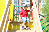 Happy little boy on playpit in summer — Foto Stock