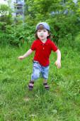 Cute little boy running in summer outdoors — Stock Photo