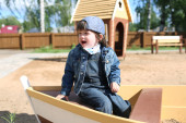 Crying little boy on playpit — Stock Photo