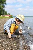Cute little child on seaside — Stock Photo