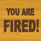 Text You Are Fired coffee on wood texture — Stock Photo