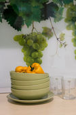 Plates, cups, grapes, kitchen — Stockfoto