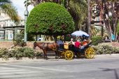 Horse carriage with tourist in andalusia street — Stock Photo