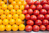 Oranges and tomatoes at market. — Stok fotoğraf