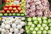 Tomatoes, garlics, onions and lettuces from the market. — Stock Photo