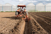 Tractor preparation soil working in field agriculture. — Foto Stock