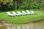 White chair and green grass in vang vieng, laos. Concept for res — Stock Photo