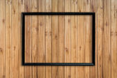 Old frame picture on wood background with space. — 图库照片