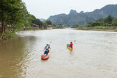 VANG VIENG, LAO P.D.R. - October 24 : Unidentified tourists are — Stock Photo