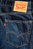 Closeup of leather like heavy card stock label of a pair of Levi's brand of denim jeans. — Stock Photo
