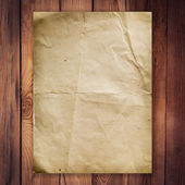 Old paper on wood background and texture — Stock Photo