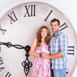Happy Pregnant Couple on white background with giant clock — Stock Photo #57535485