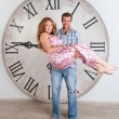 Happy Pregnant Couple on white background with giant clock — Stock Photo #57535519