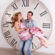 Happy Pregnant Couple on white background with giant clock — Stock Photo #57538025