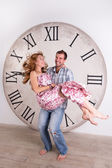 Happy Pregnant Couple on white background with giant clock — Foto Stock
