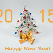 New year 2015 sign with christmas tree toy on white background. Happy new year card — Stock Photo #59816703