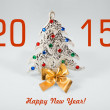 New year 2015 sign with christmas tree toy on white background. Happy new year card — Stock Photo #59816707