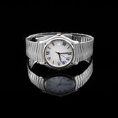 Swiss watches on black background — Stock Photo