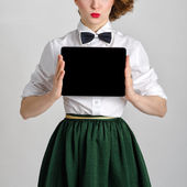 Business woman holding and shows touch screen tablet pc with blank screen — Stock Photo