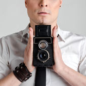 Business man holding rarity old photographic camera closeup. — Stock Photo