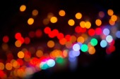 Colorful bokeh on a dark background. Defocused bokeh lignts. Abstract Christmas batskground. Abstract circular bokeh background of Christmaslight. — Stock Photo