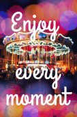 ENJOY EVERY MOMENT. Inspirational Typographic Quote. Merry-Go-Round illuminated at night with colorful bokeh. — Stock Photo