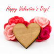 Wooden heart with pink and red wool flowers on white background. Valentines Day greeting card. — Stockfoto #62355193