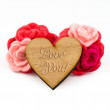 Wooden heart with carved words and red wool flowers on white background. Valentines Day greeting card. — Stok fotoğraf #62355199