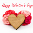 Wooden heart with pink and red wool flowers on white background. Valentines Day greeting card. — Stockfoto #62355211