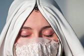 Arabian woman wearing hijab. Young girl with closed eyes showing her makeup. Concept of silence, isolation and secrecy. — Stock Photo