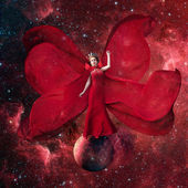 Red space queen. Beautiful woman in a fluttering dress standing and balancing on the planet in outer space. Fantastic art work. Elements of this image furnished by NASA. — Stock Photo