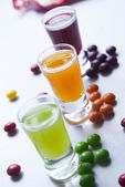 Vodka with colorful candy — Stock Photo