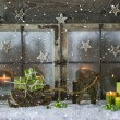 Natural wooden christmas decoration with candles and green prese — Stock Photo #52360707