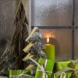 Natural wooden christmas decoration with candles and green prese — Stock Photo #52360727