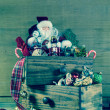 Santa Claus with presents for christmas decoration on wood. — Stock Photo #52361467
