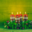 Traditional advent wreath or crown with four red burning candles — Stock Photo #52362899