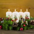 Advent wreath or crown with four burning white candles. — Stock Photo #52364303