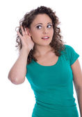 Isolated young funny woman in green listening for special sales — Stock Photo