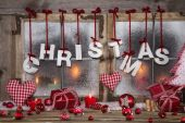 Country style christmas decoration in red, white and wood on an  — Stock Photo