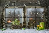 Natural wooden christmas decoration with candles and green prese — Stock Photo