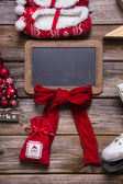 Christmas or advent wooden sign with red decoration for a greeti — Foto de Stock