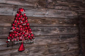 Wooden old christmas background with a red tree of balls. — Photo