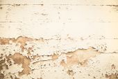 Old wooden nostalgic background with peeled color in beige. — Foto de Stock