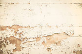 Old wooden nostalgic background with peeled color in beige. — Stock Photo
