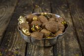 Bowl of walnuts for christmas time on wooden old background. — Stock Photo