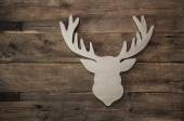 Deer head with antler for christmas decoration on wooden backgro — Stock Photo
