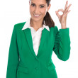 Isolated businesswoman in green making excellent gesture with fi — Stock Photo #52506655