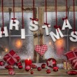 Christmas greeting card in red, wood, candles and with text. — Stock Photo #52509945